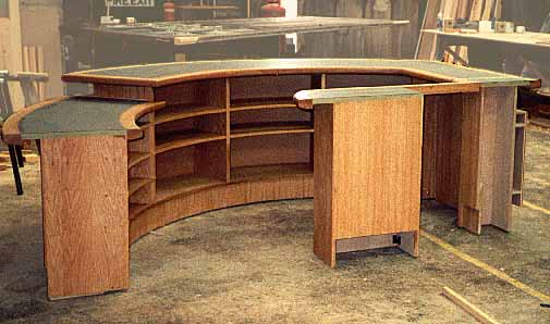 A curved reception counter designed and manufactured by Jacobs Joinery of Havant Hampshire